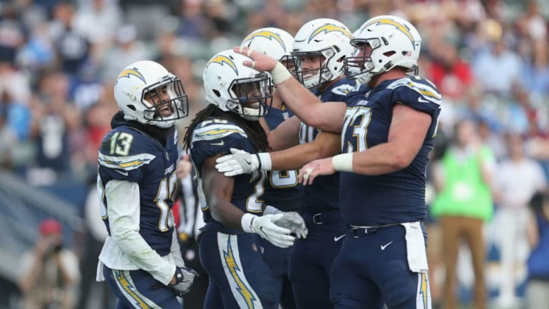 CARSON, CA - DECEMBER 10: Running back Melvin Gordon #28 (second from left) of the Los Angeles Chargers celebrates with Spencer Pulley #73, Hunter Henry #86, and Keenan Allen #13 after scoring on a one yard touchdown run in the third quarter against the Washington Redskins on December 10, 2017 at StubHub Center in Carson, California. The Chargers won 30-16. (Photo by Stephen Dunn/Getty Images)