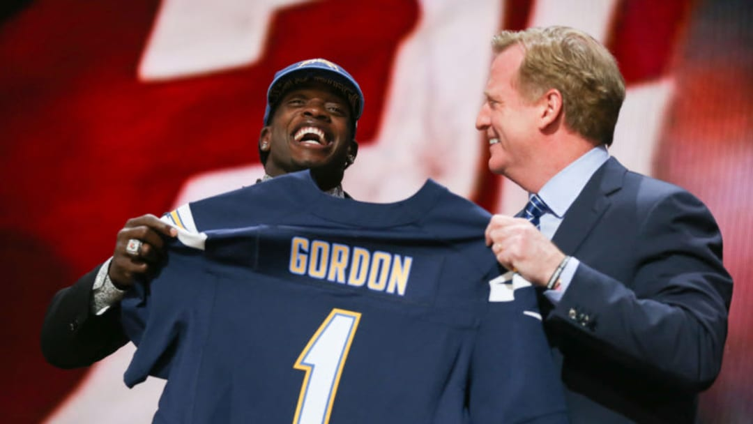 CHICAGO, IL - APRIL 30: Melvin Gordon of the Wisconsin Badgers holds up a jersey with NFL Commissioner Roger Goodell after being picked