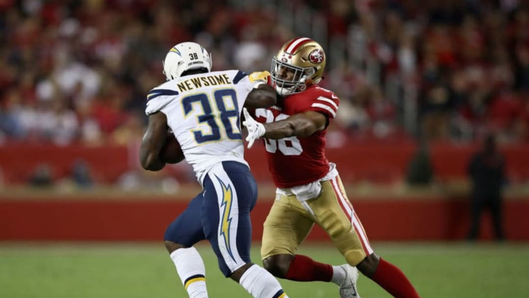 SANTA CLARA, CA - AUGUST 30: Detrez Newsome #38 of the Los Angeles Chargers is tackled by Antone Exum #38 of the San Francisco 49ers during their preseason game at Levi's Stadium on August 30, 2018 in Santa Clara, California. (Photo by Ezra Shaw/Getty Images)