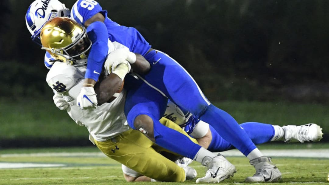 DURHAM, NORTH CAROLINA - NOVEMBER 09: Chris Rumph II #96 of the Duke Blue Devils tackles Jahmir Smith #34 of the Notre Dame Fighting Irish during the second half of their game at Wallace Wade Stadium on November 09, 2019 in Durham, North Carolina. (Photo by Grant Halverson/Getty Images)
