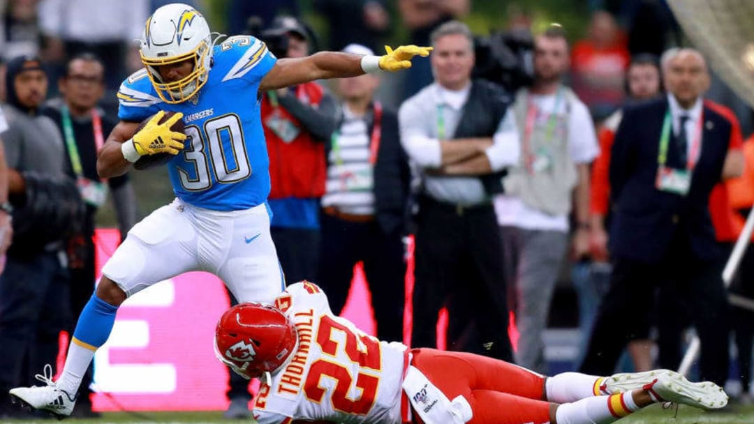 MEXICO CITY, MEXICO - NOVEMBER 18: Running back Austin Ekeler #30 of the Los Angeles Chargers is tackled by free safety Juan Thornhill #22 of the Kansas City Chiefs during the first quart of the game at Estadio Azteca on November 18, 2019 in Mexico City, Mexico. (Photo by Manuel Velasquez/Getty Images)