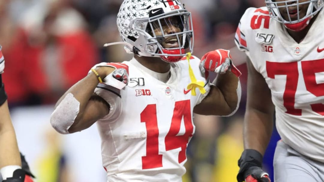 INDIANAPOLIS, INDIANA - DECEMBER 07: K.J. Hill Jr. #14 of the Ohio State Buckeyes celebrates after catching a touchdown pass during the BIG Ten Football Championship Game against the Wisconsin Badgers at Lucas Oil Stadium on December 07, 2019 in Indianapolis, Indiana. (Photo by Andy Lyons/Getty Images)