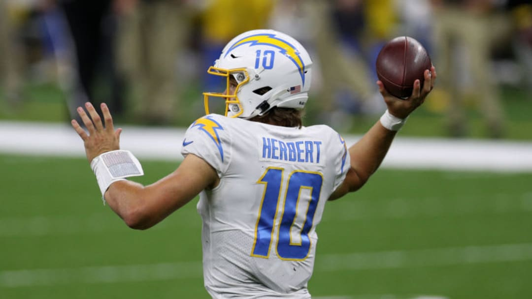 NEW ORLEANS, LOUISIANA - OCTOBER 12: Justin Herbert #10 of the Los Angeles Chargers looks to pass against the New Orleans Saints during their NFL game at Mercedes-Benz Superdome on October 12, 2020 in New Orleans, Louisiana. (Photo by Chris Graythen/Getty Images)