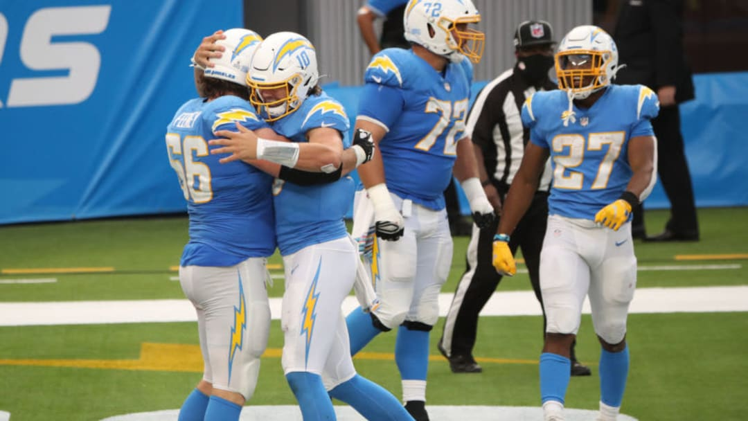INGLEWOOD, CALIFORNIA - OCTOBER 25: Quarterback Justin Herbert #10 and Dan Feeney #66 of the Los Angeles Chargers celebrate during the third quarter against the Jacksonville Jaguars at SoFi Stadium on October 25, 2020 in Inglewood, California. (Photo by Katelyn Mulcahy/Getty Images)