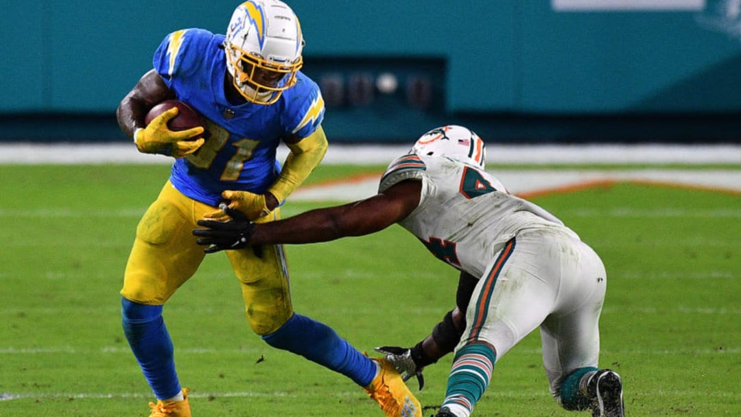 MIAMI GARDENS, FLORIDA - NOVEMBER 15: Kalen Ballage #31 of the Los Angeles Chargers runs the ball against Elandon Roberts #44 of the Miami Dolphins during the second half at Hard Rock Stadium on November 15, 2020 in Miami Gardens, Florida. (Photo by Mark Brown/Getty Images)