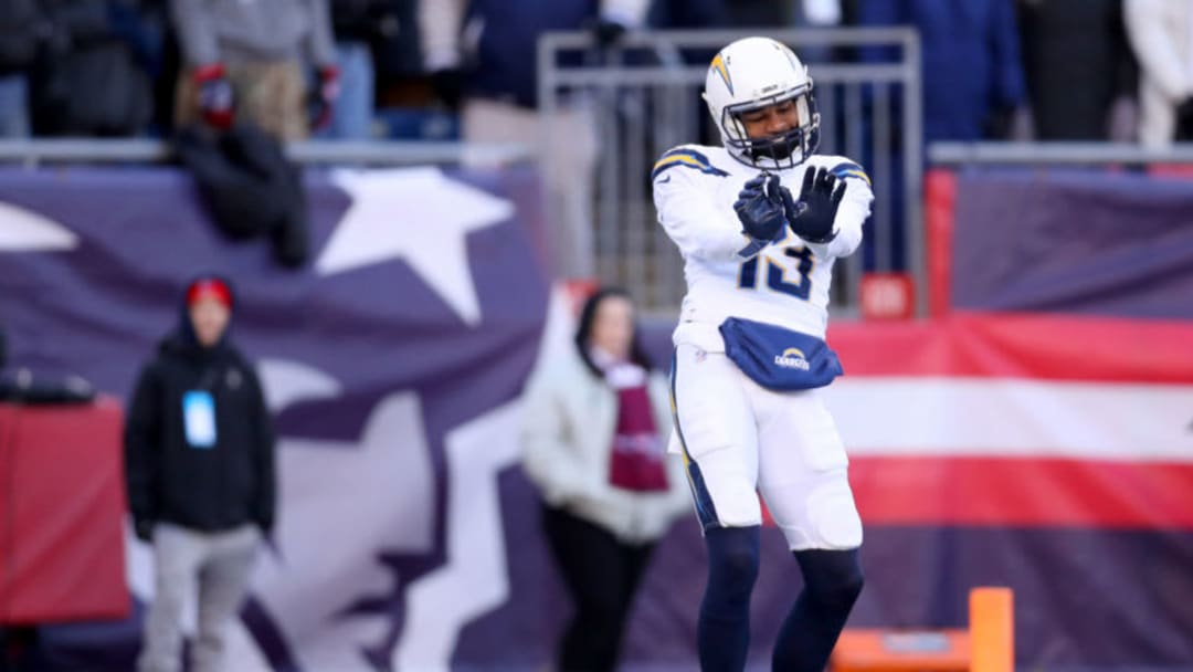 FOXBOROUGH, MASSACHUSETTS - JANUARY 13: Keenan Allen #13 of the Los Angeles Chargers reacts after catching a touchdown pass during the first quarter in the AFC Divisional Playoff Game against the New England Patriots at Gillette Stadium on January 13, 2019 in Foxborough, Massachusetts. (Photo by Maddie Meyer/Getty Images)