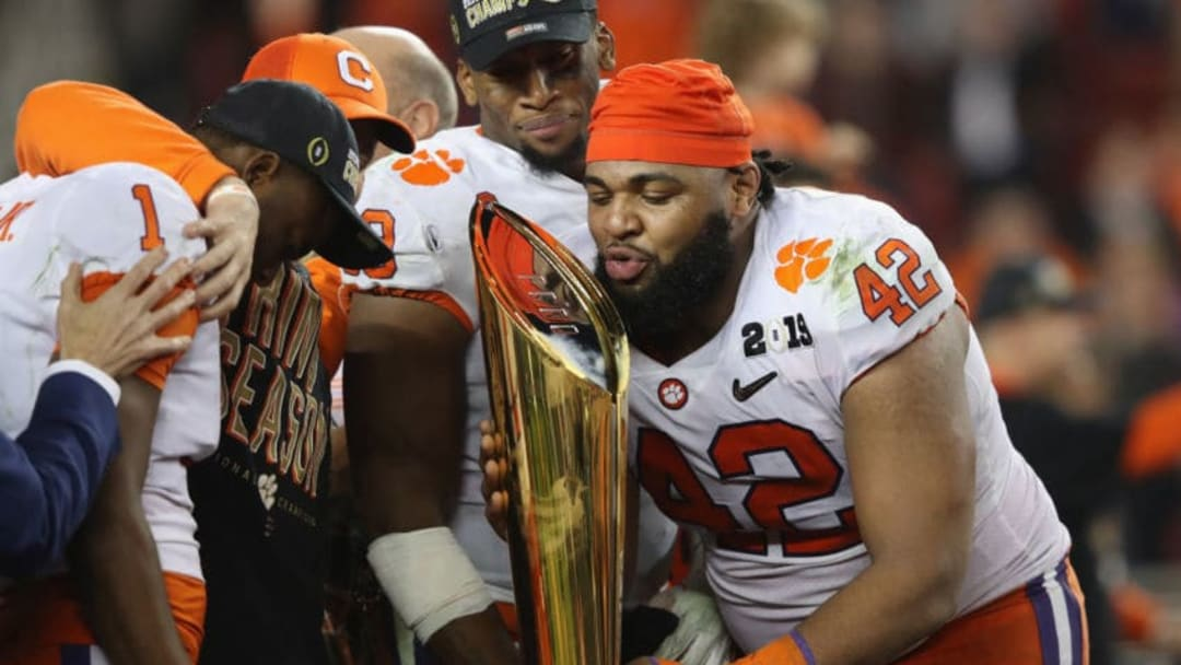 SANTA CLARA, CA - JANUARY 07: Christian Wilkins #42 of the Clemson Tigers celebrates with the trophy after his teams 44-16 win over the Alabama Crimson Tide in the CFP National Championship presented by AT&T at Levi's Stadium on January 7, 2019 in Santa Clara, California. (Photo by Sean M. Haffey/Getty Images)