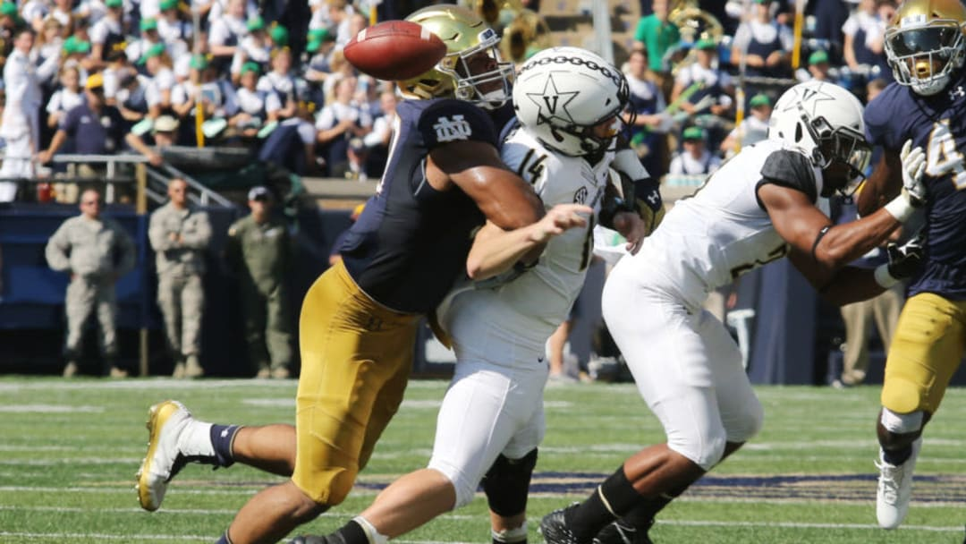 SOUTH BEND, IN - SEPTEMBER 15: Notre Dame Fighting Irish defensive lineman Jerry Tillery (99) causes a fumble by Vanderbilt Commodores quarterback Kyle Shurmur (14), the Commodores recover football during the college football game between the Notre Dame Fighting Irish and the Vanderbilt Commodores on September 15, 2018, at Notre Dame Stadium in South Bend, Indiana. (Photo by Marcus Snowden/Icon Sportswire via Getty Images)