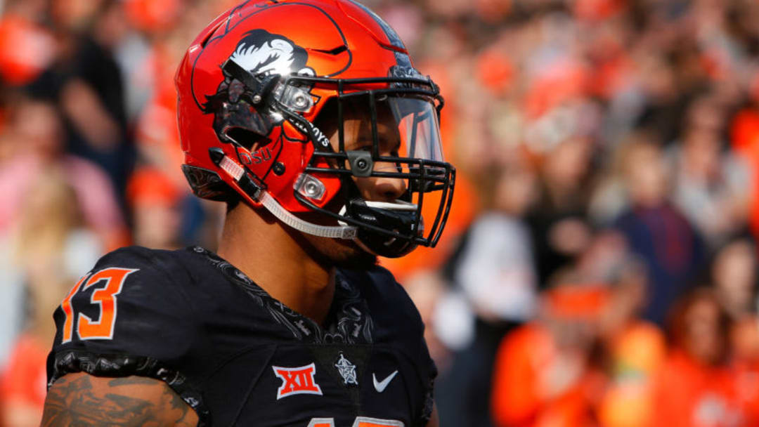 STILLWATER, OK - NOVEMBER 17: Wide receiver Tyron Johnson #13 of the Oklahoma State Cowboys heads onto the field for a game against the West Virginia Mountaineers on November 17, 2018 at Boone Pickens Stadium in Stillwater, Oklahoma. Oklahoma State won 45-41. (Photo by Brian Bahr/Getty Images)