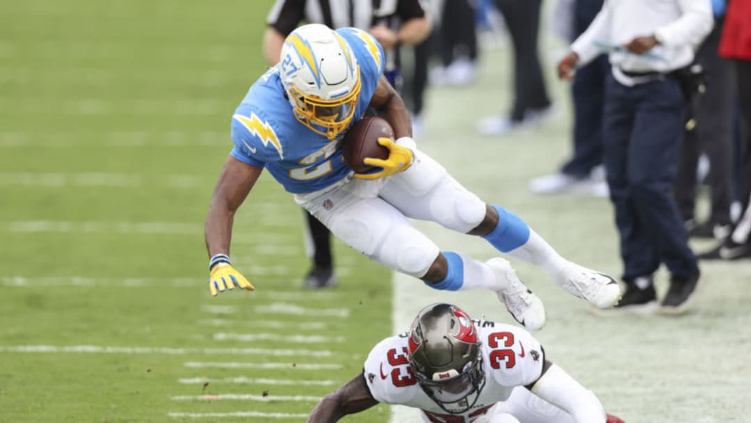 TAMPA, FLORIDA - OCTOBER 04: Joshua Kelley #27 of the Los Angeles Chargers is tackled by Jordan Whitehead #33 of the Tampa Bay Buccaneers during the second quarter of a game at Raymond James Stadium on October 04, 2020 in Tampa, Florida. (Photo by James Gilbert/Getty Images)