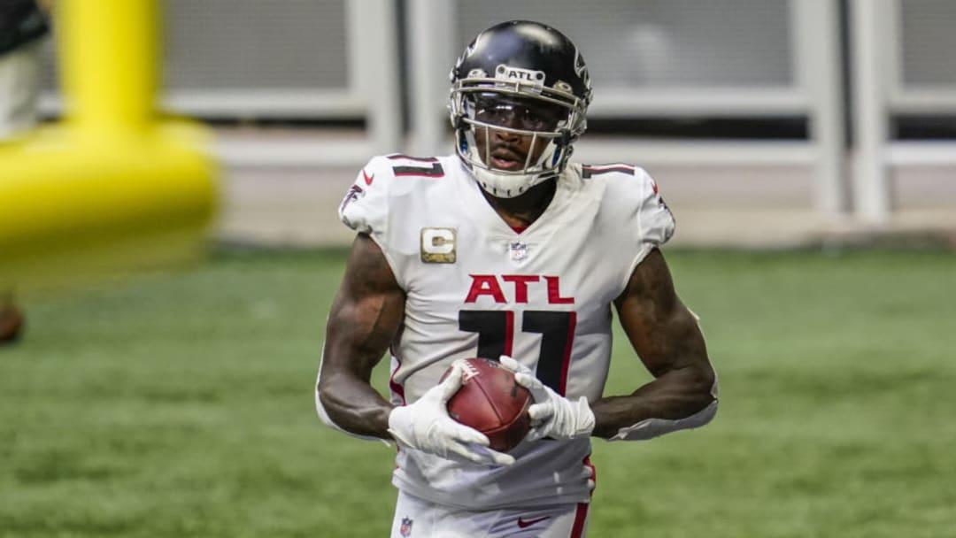 Nov 8, 2020; Atlanta, Georgia, USA; Atlanta Falcons wide receiver Julio Jones (11) catches a touchdown pass against the Denver Broncos during the second half at Mercedes-Benz Stadium. Mandatory Credit: Dale Zanine-USA TODAY Sports