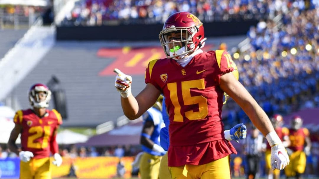 LOS ANGELES, CA - NOVEMBER 23: USC Trojans wide receiver Drake London (15) celebrates after a long reception during a college football game between the UCLA Bruins and the USC Trojans on November 23, 2019, at Los Angeles Memorial Coliseum in Los Angeles, CA. (Photo by Brian Rothmuller/Icon Sportswire via Getty Images)