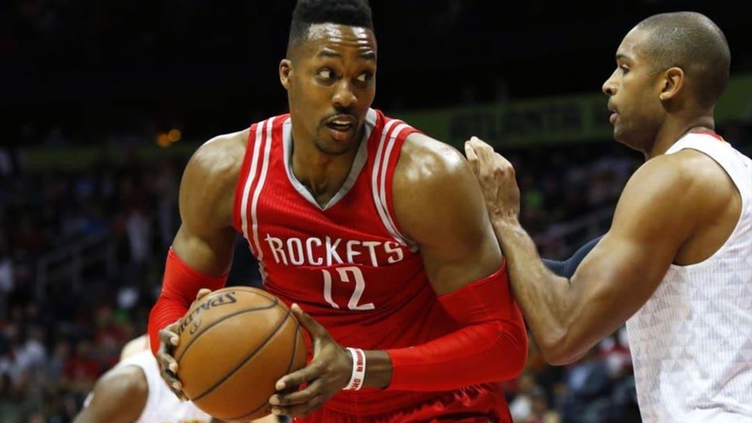 Mar 19, 2016; Atlanta, GA, USA; Houston Rockets center Dwight Howard (12) is defended by Atlanta Hawks center Al Horford (15) in the first quarter at Philips Arena. Mandatory Credit: Brett Davis-USA TODAY Sports