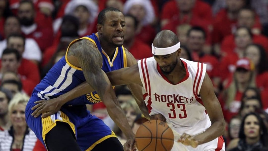 May 23, 2015; Houston, TX, USA; Houston Rockets guard Corey Brewer (33) and Golden State Warriors guard Andre Iguodala (9) fight for a ball during the game in game three of the Western Conference Finals of the NBA Playoffs at Toyota Center. Mandatory Credit: Troy Taormina-USA TODAY Sports