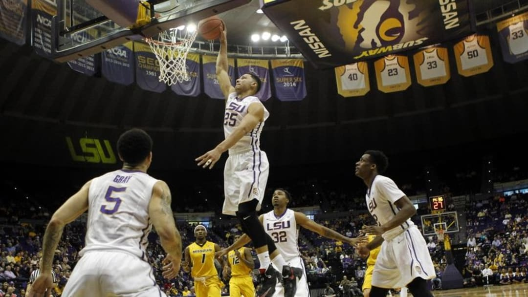 Mar 1, 2016; Baton Rouge, LA, USA; LSU Tigers forward Ben Simmons (25) goes up to dunk the ball during the first half against the Missouri Tigers at the Pete Maravich Assembly Center. LSU defeated Missouri 80-71. Mandatory Credit: Crystal LoGiudice-USA TODAY Sports
