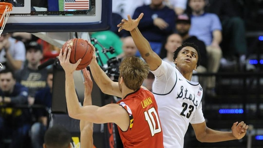 Mar 12, 2016; Indianapolis, IN, USA; Maryland Terrapins forward Jake Layman (10) shoots the ball as Michigan State Spartans forward Deyonta Davis (23) defends in the second half during the Big Ten Conference tournament at Bankers Life Fieldhouse. Mandatory Credit: Thomas J. Russo-USA TODAY Sports
