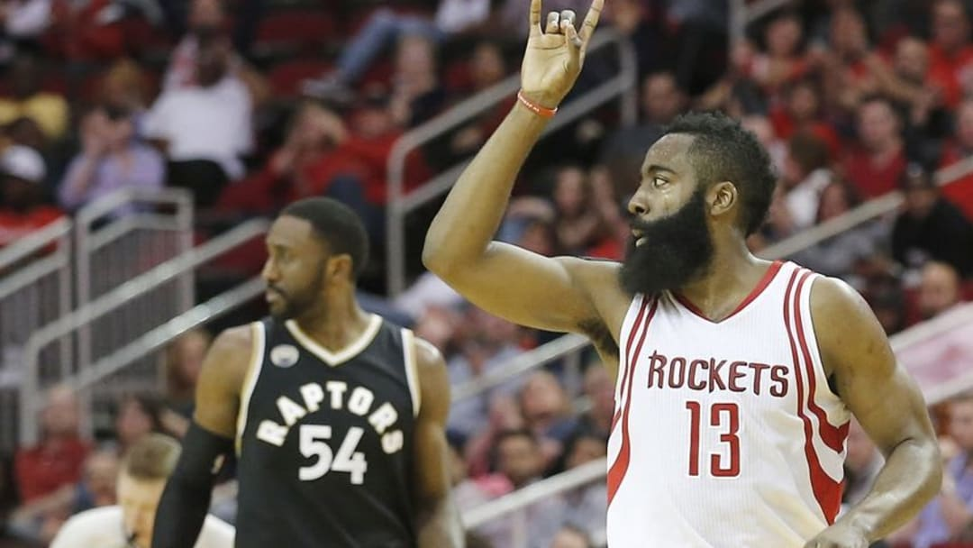 Mar 25, 2016; Houston, TX, USA; Houston Rockets guard James Harden (13) celebrates after scoring against the Toronto Raptors in the second half at Toyota Center. The Rockets won 112 to 109. Mandatory Credit: Thomas B. Shea-USA TODAY Sports