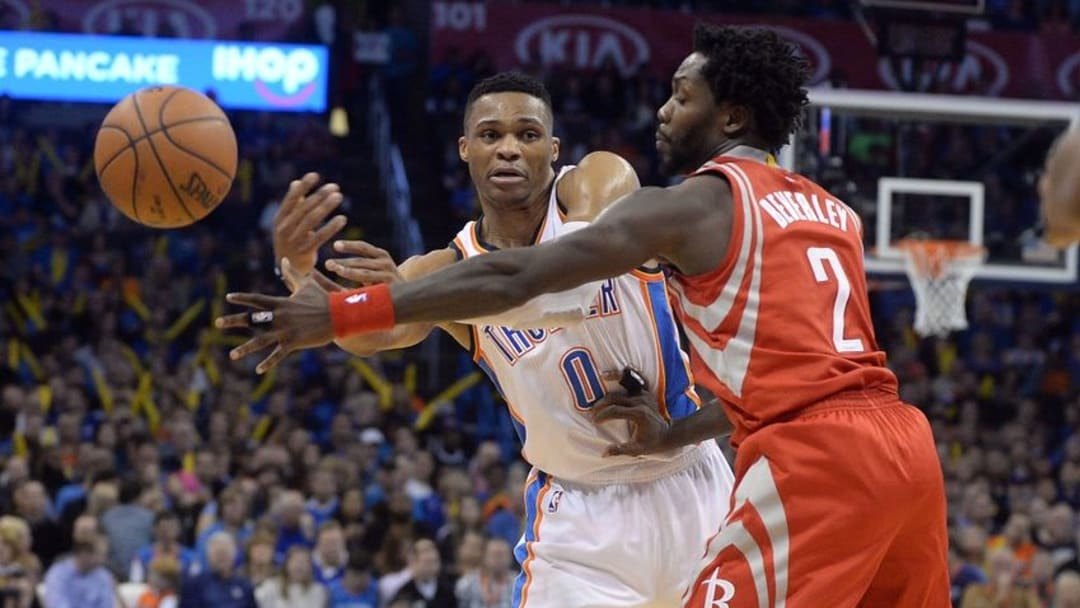 Jan 29, 2016; Oklahoma City, OK, USA; Oklahoma City Thunder guard Russell Westbrook (0) passes the ball in front of Houston Rockets guard Patrick Beverley (2) during the third quarter at Chesapeake Energy Arena. Mandatory Credit: Mark D. Smith-USA TODAY Sports