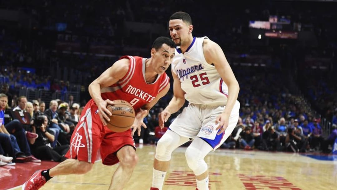 May 14, 2015; Los Angeles, CA, USA; Houston Rockets guard Pablo Prigioni (9) drives past Los Angeles Clippers guard Austin Rivers (25) in game six of the second round of the NBA Playoffs at Staples Center. Mandatory Credit: Richard Mackson-USA TODAY Sports