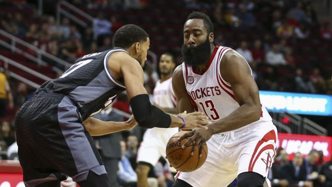 Dec 14, 2016; Houston, TX, USA; Houston Rockets guard James Harden (13) attempts to drive the ball past Sacramento Kings guard Garrett Temple (17) during the first quarter at Toyota Center. Mandatory Credit: Troy Taormina-USA TODAY Sports