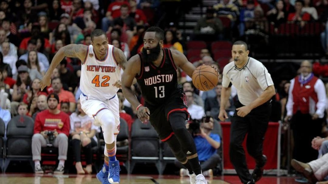 Dec 31, 2016; Houston, TX, USA; Houston Rockets guard James Harden (13) pushes the ball upcourt while New York Knicks forward Lance Thomas (42) pursues during the second quarter at Toyota Center. Mandatory Credit: Erik Williams-USA TODAY Sports
