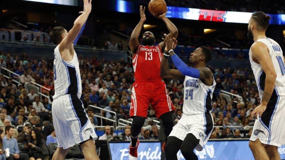 Jan 6, 2017; Orlando, FL, USA; Houston Rockets guard James Harden (13) shoots over Orlando Magic forward Jeff Green (34) and center Nikola Vucevic (9) during the second quarter at Amway Center. Mandatory Credit: Kim Klement-USA TODAY Sports