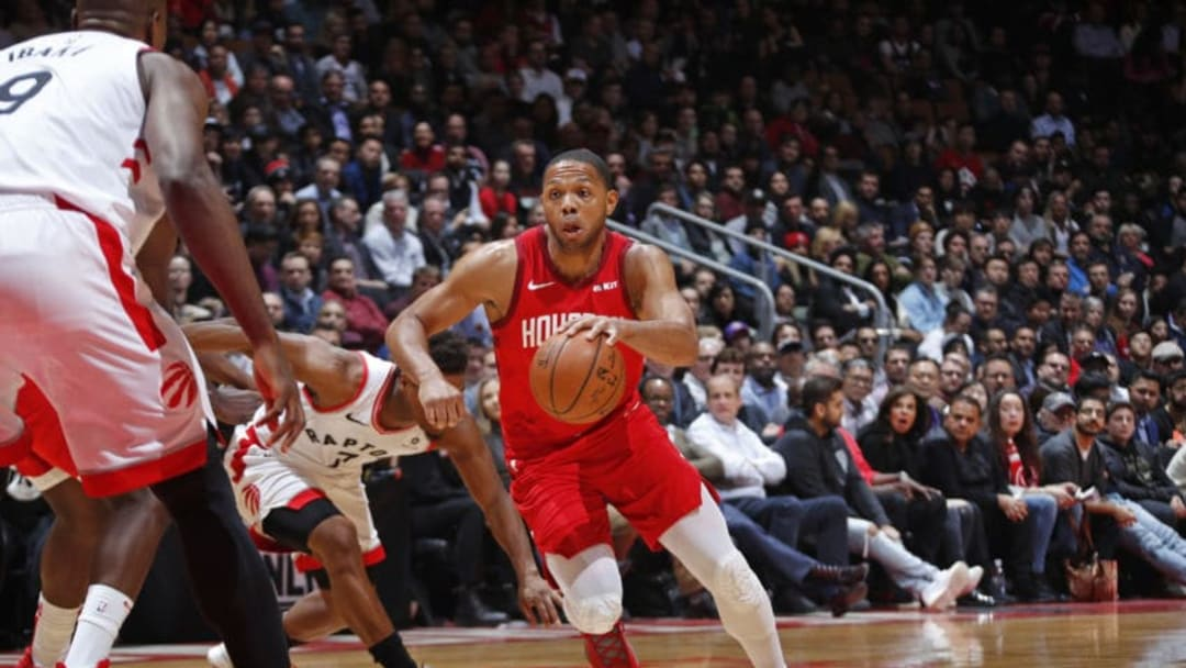 Eric Gordon #10 of the Houston Rockets handles the ball against the Toronto Raptors (Photo by Mark Blinch/NBAE via Getty Images)
