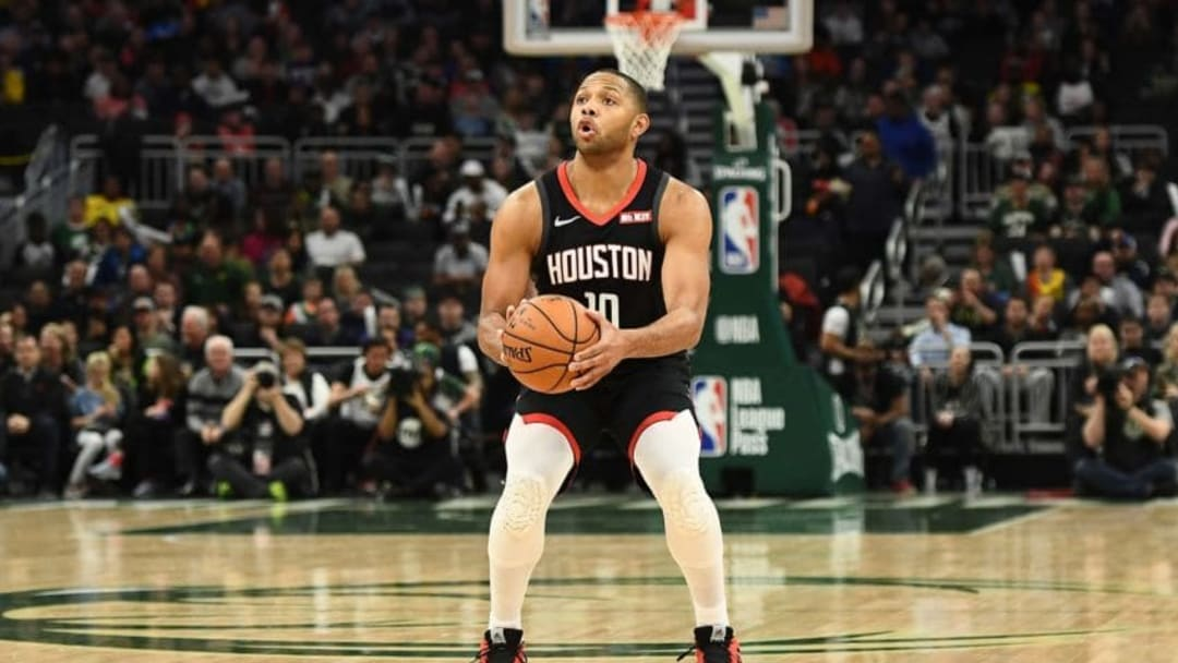 Eric Gordon #10 of the Houston Rockets takes a three point shot during a game against the Milwaukee Bucks (Photo by Stacy Revere/Getty Images)