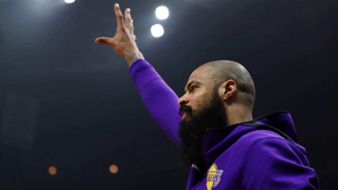 Tyson Chandler #5 of the Los Angeles Lakers celebrates after a dunk by JaVale McGee #7 against the Los Angeles Clippers (Photo by Yong Teck Lim/Getty Images)