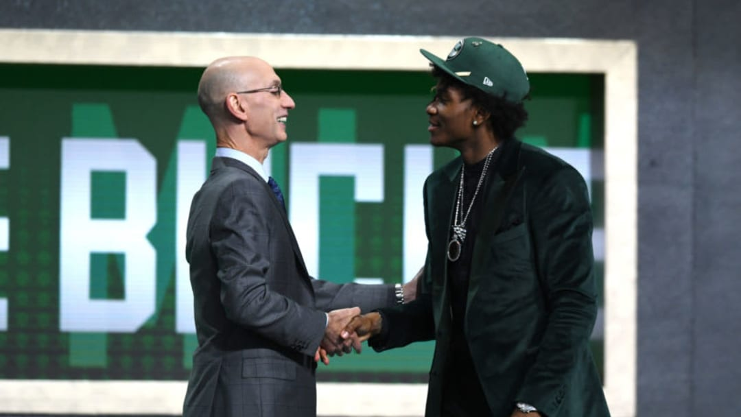 Kevin Porter Jr. poses with NBA Commissioner Adam Silver (Photo by Sarah Stier/Getty Images)