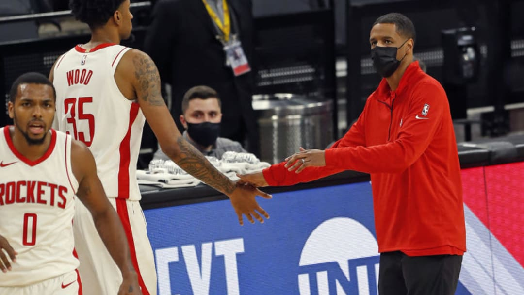 Stephen Silas head coach of the Houston Rockets greets Christian Wood #35 (Photo by Ronald Cortes/Getty Images)