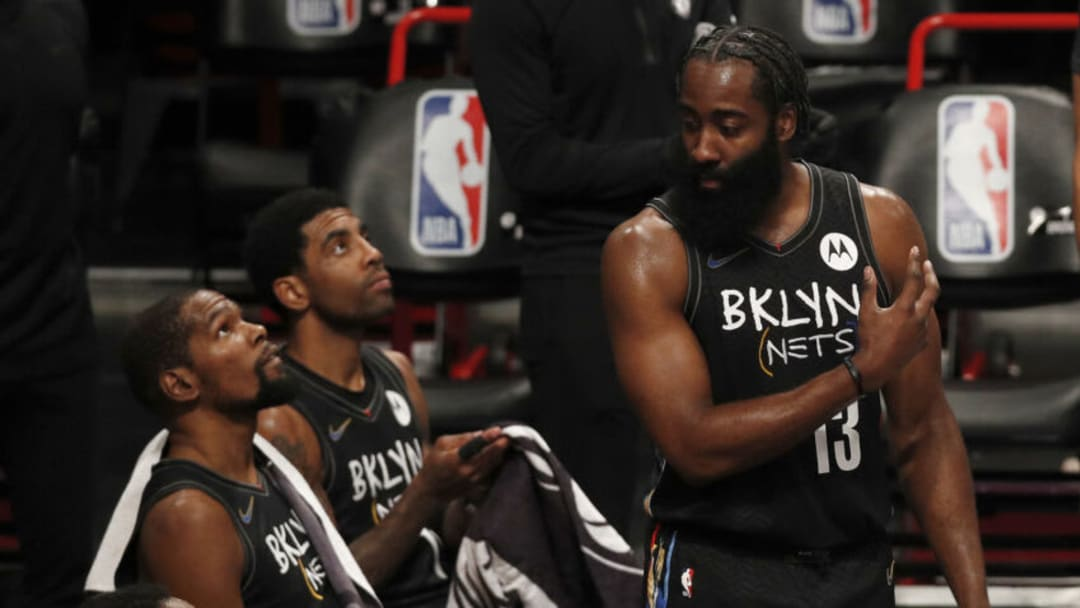 NEW YORK, NEW YORK - FEBRUARY 05: (NEW YORK DAILIES OUT) James Harden #13, Kevin Durant #7 (L) and Kyrie Irving #11 (C) of the Brooklyn Nets look on against the Toronto Raptors at Barclays Center on February 05, 2021 in New York City. The Raptors defeated the Nets 123-117. NOTE TO USER: User expressly acknowledges and agrees that, by downloading and/or using this Photograph, user is consenting to the terms and conditions of the Getty Images License Agreement. (Photo by Jim McIsaac/Getty Images)