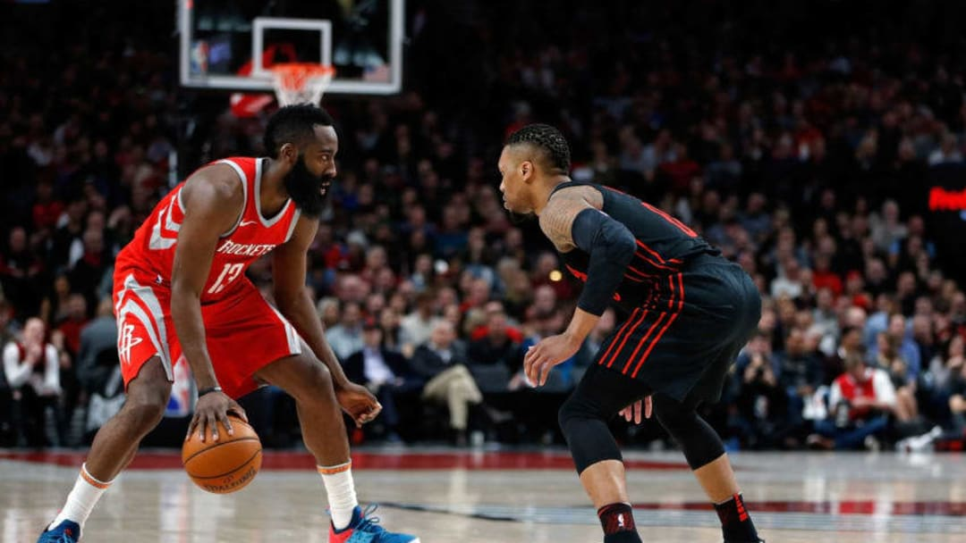 James Harden #13 of the Houston Rockets in action against Damian Lillard #0 of the Portland Trail Blazers (Photo by Jonathan Ferrey/Getty Images)