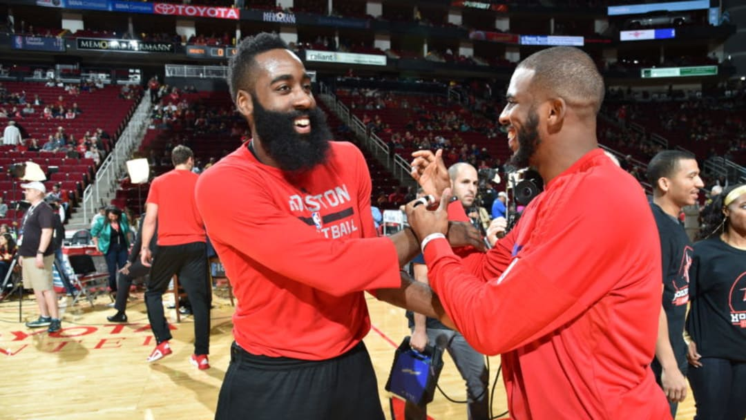 HOUSTON, TX - DECEMBER 19: James Harden #13 of the Houston Rockets and Chris Paul #3 of the Los Angeles Clippers shake hands before the game on December 19, 2015 at the Toyota Center in Houston, Texas. NOTE TO USER: User expressly acknowledges and agrees that, by downloading and or using this photograph, User is consenting to the terms and conditions of the Getty Images License Agreement. Mandatory Copyright Notice: Copyright 2015 NBAE (Photo by Bill Baptist/NBAE via Getty Images)
