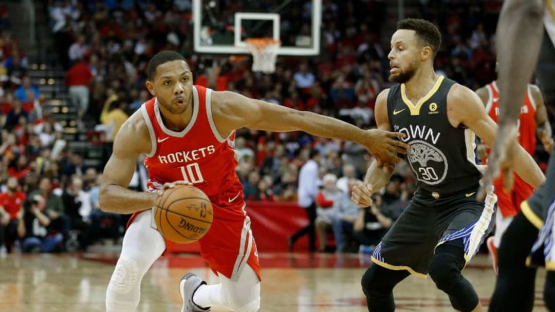 Eric Gordon #10 of the Houston Rockets drives on Stephen Curry #30 of the Golden State Warriors (Photo by Bob Levey/Getty Images)