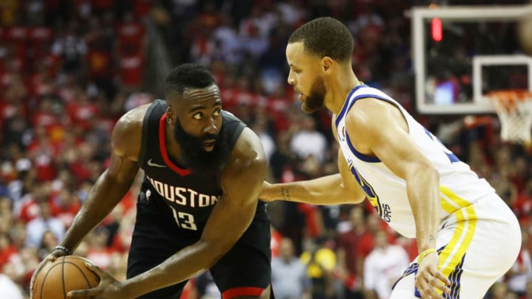 HOUSTON, TX - MAY 24: James Harden #13 of the Houston Rockets drives against Stephen Curry #30 of the Golden State Warriors in the first half of Game Five of the Western Conference Finals of the 2018 NBA Playoffs at Toyota Center on May 24, 2018 in Houston, Texas. (Photo by Ronald Martinez/Getty Images)