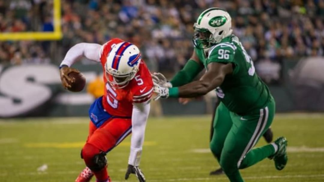 Nov 12, 2015; East Rutherford, NJ, USA;New York Jets defensive end Muhammad Wilkerson (96) tries to tackle Buffalo Bills quarterback Tyrod Taylor (5) in the second half at MetLife Stadium. The Bills defeated the Jets 22-17 Mandatory Credit: William Hauser-USA TODAY Sports