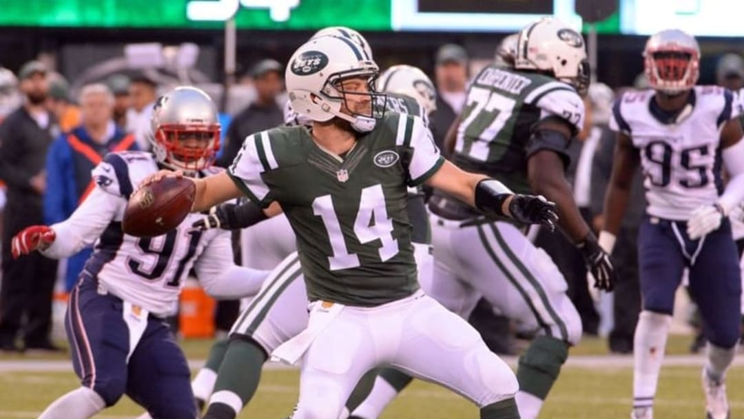 Dec 27, 2015; East Rutherford, NJ, USA; New York Jets quarterback Ryan Fitzpatrick (14) throws a pass during the fourth quarter against the New England Patriots at MetLife Stadium. Mandatory Credit: Robert Deutsch-USA TODAY Sports