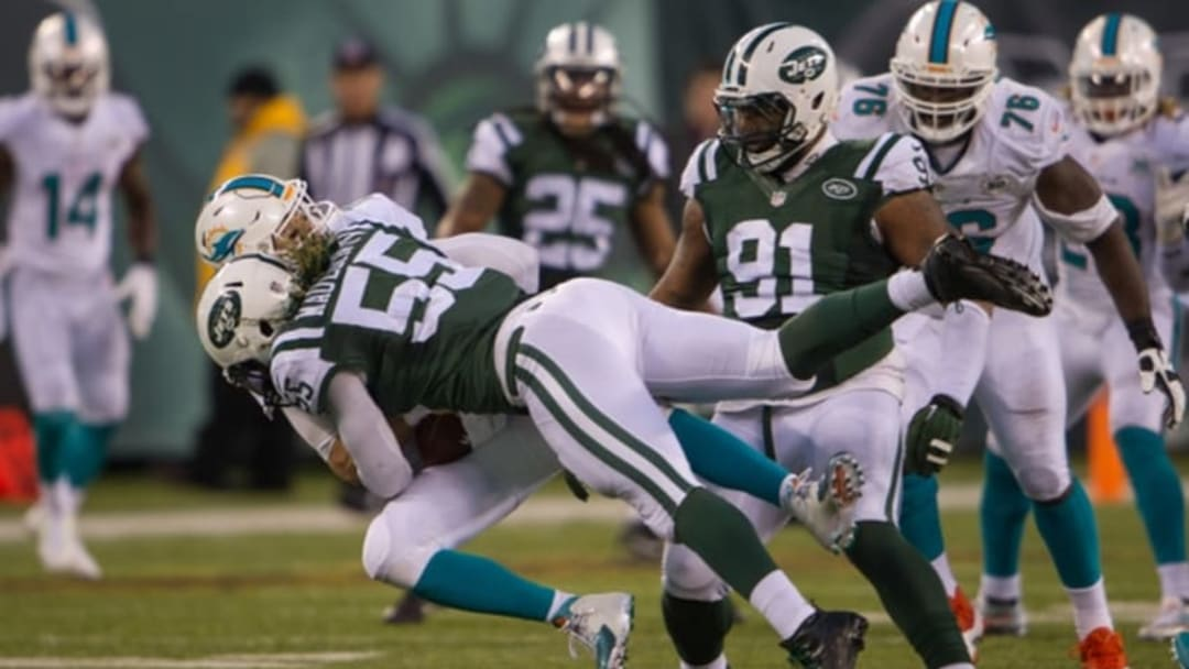 Nov 29, 2015; East Rutherford, NJ, USA; New York Jets outside linebacker Lorenzo Mauldin (55) hits Miami Dolphins quarterback Ryan Tannehill (17) In the 2nd half at MetLife Stadium.The Jets defeated the Dolphins 38-20. Mandatory Credit: William Hauser-USA TODAY Sports