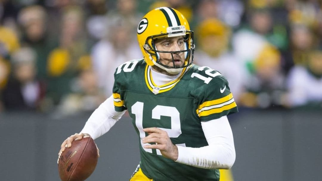 Jan 3, 2016; Green Bay, WI, USA; Green Bay Packers quarterback Aaron Rodgers (12) scrambles with the football during the second quarter against the Minnesota Vikings at Lambeau Field. Mandatory Credit: Jeff Hanisch-USA TODAY Sports