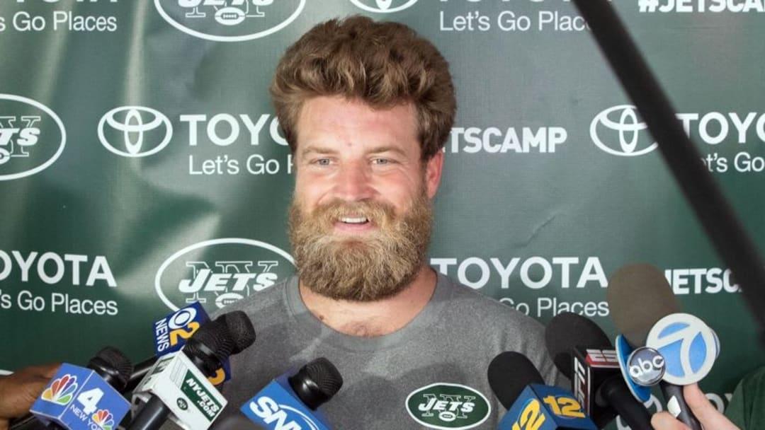 Jul 28, 2016; Florham Park, NJ, USA; New York Jets quarterback Ryan Fitzpatrick (14) speaks to the media during training camp at Atlantic Health Jets Training Center. Mandatory Credit: Vincent Carchietta-USA TODAY Sports