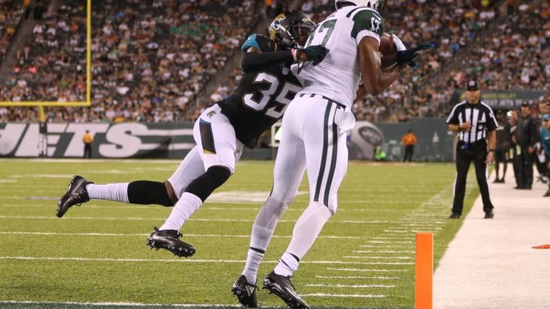Aug 11, 2016; East Rutherford, NJ, USA; New York Jets wide receiver Charone Peake (17) catches a touchdown pass as Jacksonville Jaguars cornerback Demetrius McCray (35) defends during the second half of the preseason game at MetLife Stadium. Mandatory Credit: Vincent Carchietta-USA TODAY Sports