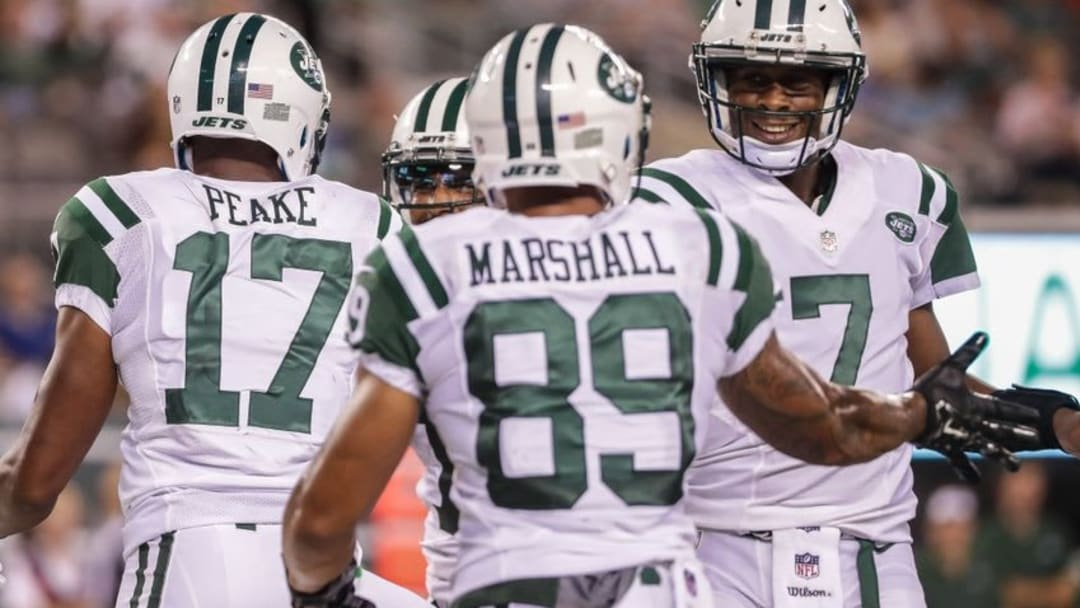 Aug 11, 2016; East Rutherford, NJ, USA; New York Jets quarterback Geno Smith (7) celebrates with wide receiver Jalin Marshall (89) after his touchdown to wide receiver Charone Peake (17) during the second half of the preseason game at MetLife Stadium. Mandatory Credit: Vincent Carchietta-USA TODAY Sports