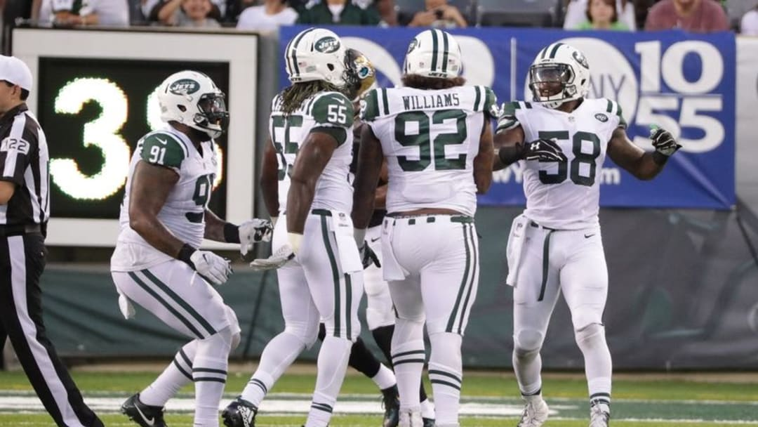 Aug 11, 2016; East Rutherford, NJ, USA; Jets defends celebrate with New York Jets defensive tackle Leonard Williams (92) during the preseason game against the Jacksonville Jaguars at MetLife Stadium. The Jets won, 17-13. Mandatory Credit: Vincent Carchietta-USA TODAY Sports