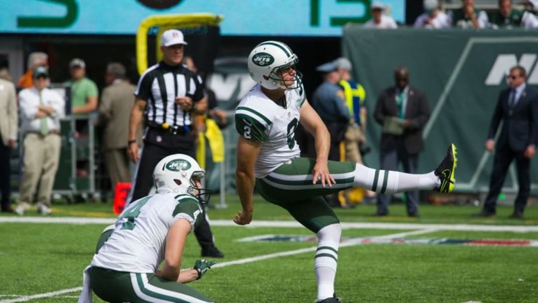 Sep 11, 2016; East Rutherford, NJ, USA; New York Jets kicker Nick Folk (2) kicks from the hold of punter Lac Edwards (4) against the Cincinnati Bengals at New York Jets in the first half at MetLife Stadium. Mandatory Credit: William Hauser-USA TODAY Sports