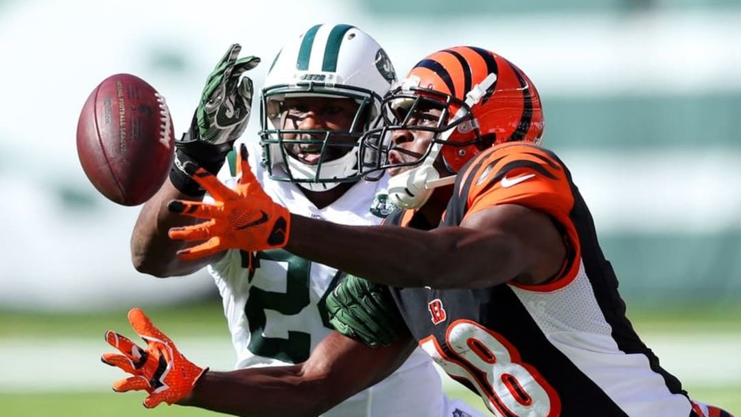 Sep 11, 2016; East Rutherford, NJ, USA; Cincinnati Bengals wide receiver A.J. Green (18) catches a pass in front of New York Jets corner back Darrelle Revis (24) during the fourth quarter at MetLife Stadium. Mandatory Credit: Brad Penner-USA TODAY Sports