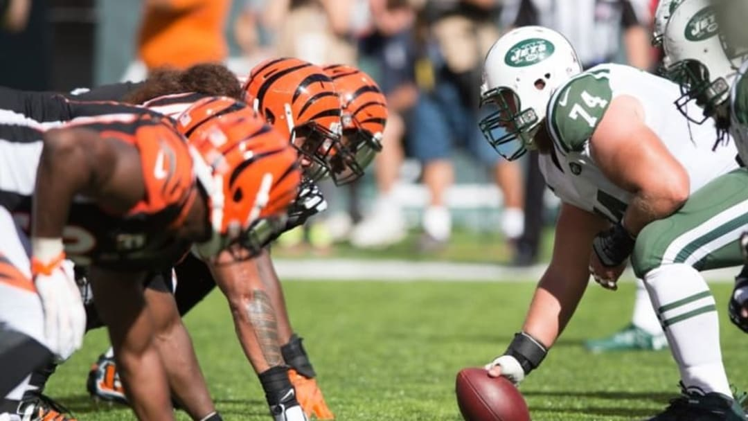Sep 11, 2016; East Rutherford, NJ, USA; New York Jets center Nick Mangold (74) looks at the Cincinnati Bengals defense in the second half at MetLife Stadium. The Bengals defeated the Jets 23-22. Mandatory Credit: William Hauser-USA TODAY Sports