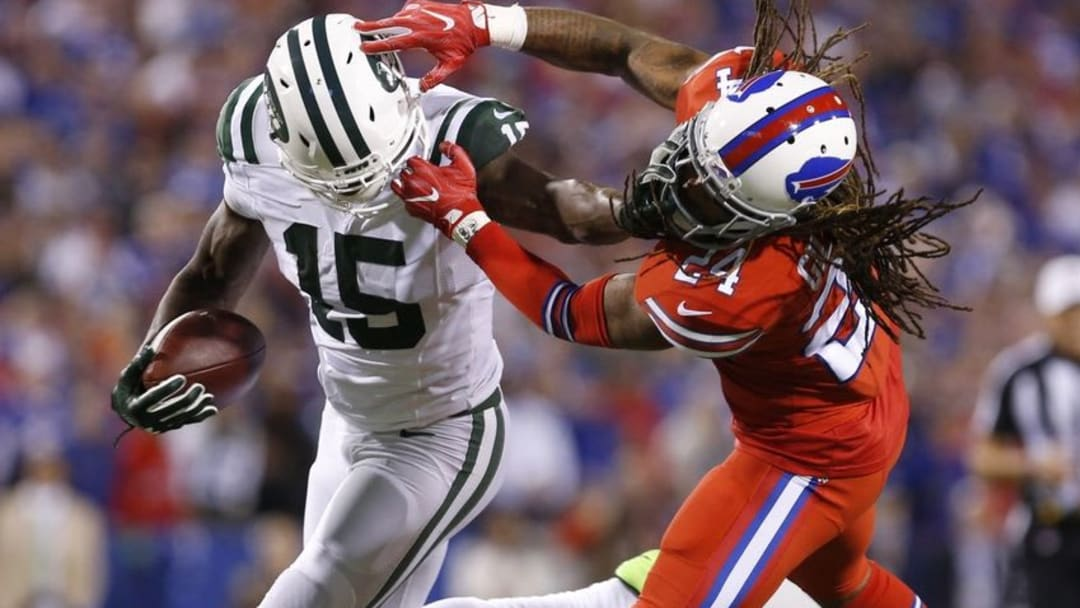 Sep 15, 2016; Orchard Park, NY, USA; New York Jets wide receiver Brandon Marshall (15) makes a catch and tries to evade Buffalo Bills cornerback Stephon Gilmore (24) during the first half at New Era Field. Mandatory Credit: Timothy T. Ludwig-USA TODAY Sports
