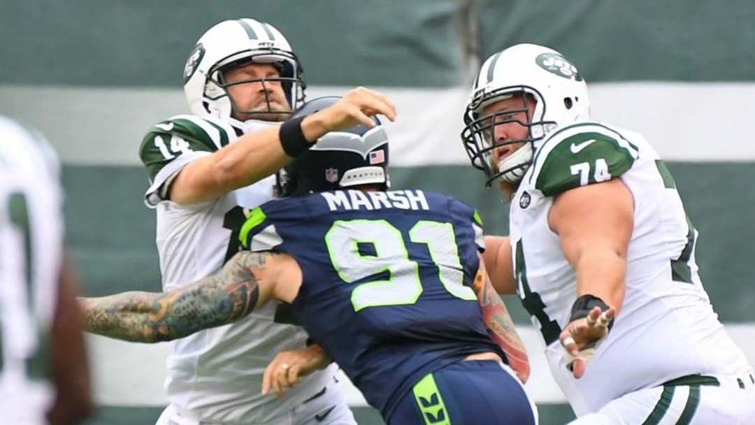 Oct 2, 2016; East Rutherford, NJ, USA; New York Jets quarterback Ryan Fitzpatrick (14) gets a completion off despite pressure from Seattle Seahawks defensive end Cassius Marsh (91) in the second quarter at MetLife Stadium. Mandatory Credit: Robert Deutsch-USA TODAY Sports