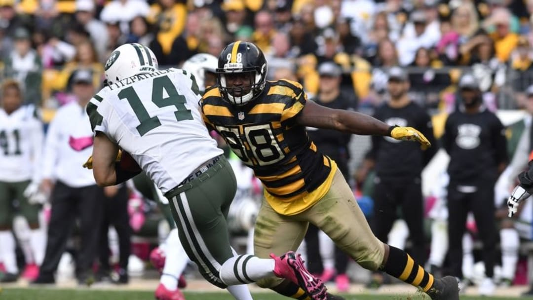 Oct 9, 2016; Pittsburgh, PA, USA; Pittsburgh Steelers inside linebacker Vince Williams (98) makes a sack on New York Jets quarterback Ryan Fitzpatrick (14) during the fourth quarter at Heinz Field. Pittsburgh won 31-13. Mandatory Credit: Mark Konezny-USA TODAY Sports
